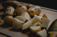 Chunks Of Potatoes On A Wooden...