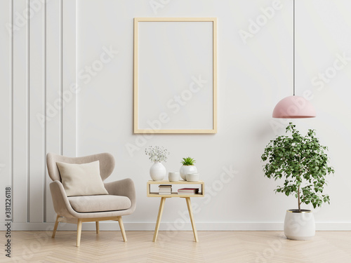 Fototapeta Poster mockup with vertical frames on empty white wall in living room interior with blue velvet armchair. obraz