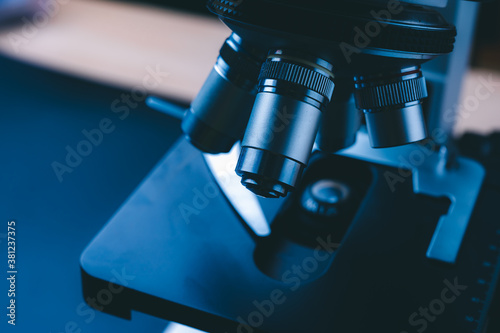 The concept of modern medical laboratory equipment, close up of objective lenses Wallpaper Mural
