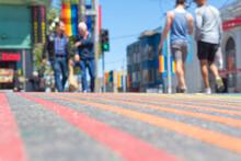 Blurred People Walking At Castro District Rainbow Crosswalk Intersection, San Francisco, California, USA