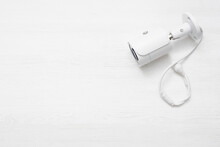 Modern White Security Camera On White Background With Copy Space.