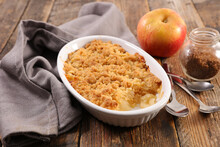 Apple Crumble On Wood Background