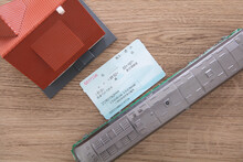 """Small Train Model And Home Model, As Well As Train Tickets For Both. The Chinese Characters Written On The Train Ticket Probably Mean: """"Train Information And Departure Time"""""""