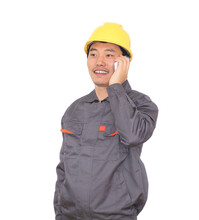 Migrant Worker Wearing Yellow Hard Hat In Front Of White Background Is Calling Home