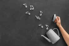 Music Notes With Teapot On Dar...