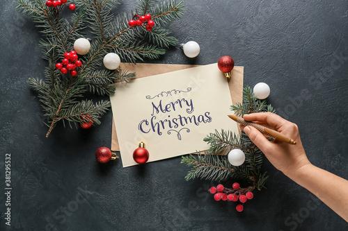 Fototapeta Beautiful greeting card for Christmas celebration on dark background obraz