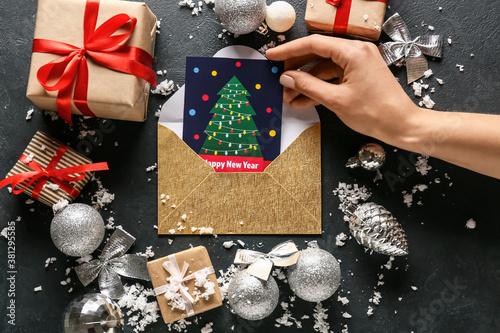 Fototapeta Beautiful greeting card for New Year celebration on dark background obraz