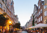 Fototapeta Uliczki - Cobblestone streets of Gdansk with rows of colorful, narrow houses in Dutch style, Poland