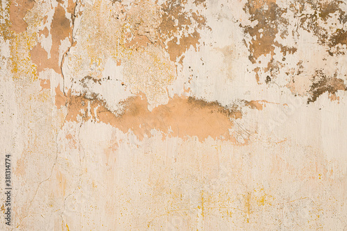 Fototapeta Grunge background of cracked cloud peeled putty wall in beige tones