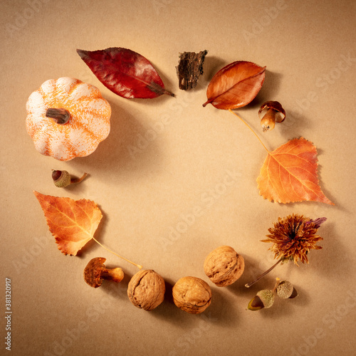 Square autumn background with fall leaves, a flat lay with copy space on a brown background