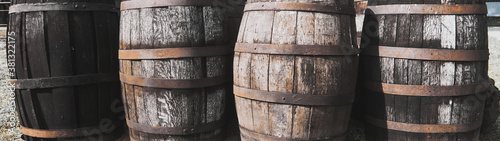 Old dirty weathered wooden barrels with rusty barrel hoops Canvas Print