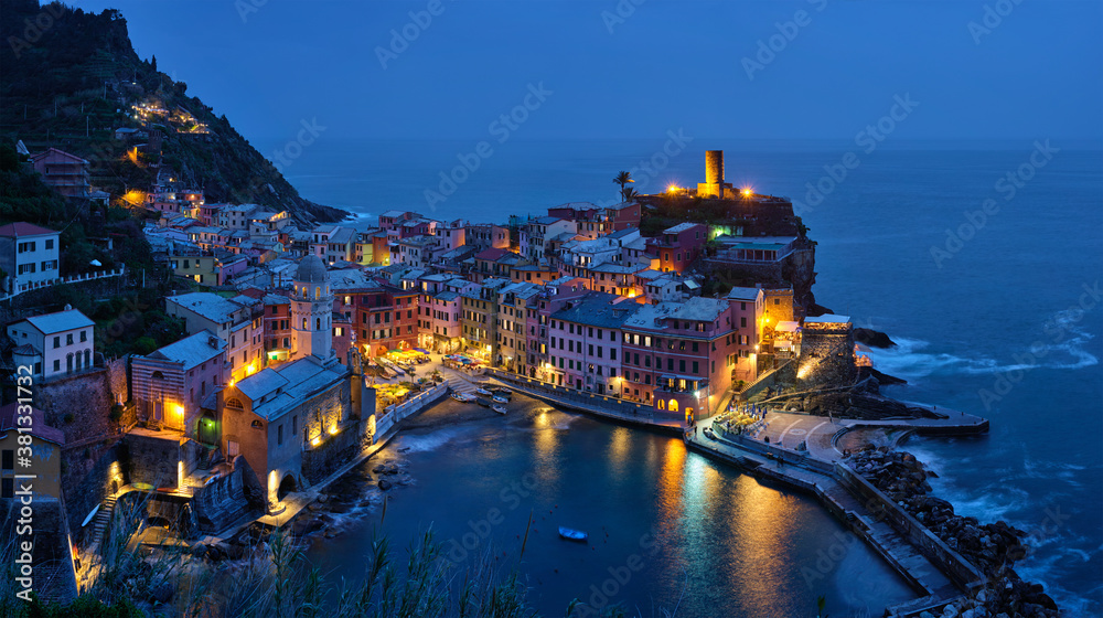 Fototapeta View of Vernazza village popular tourist destination in Cinque Terre National Park a UNESCO World Heritage Site, Liguria, Italy view illuminated in the night from Azure trail