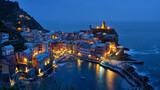 Fototapeta Kawa jest smaczna - View of Vernazza village popular tourist destination in Cinque Terre National Park a UNESCO World Heritage Site, Liguria, Italy view illuminated in the night from Azure trail