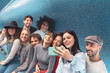 Group young friends taking selfie with mobile smartphone in subway underground metropolitan - Happy trendy people sharing time and laughing together - Youth millennial friendship lifestyle concept