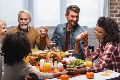 joyful and multiethnic family celebrating thanksgiving at home
