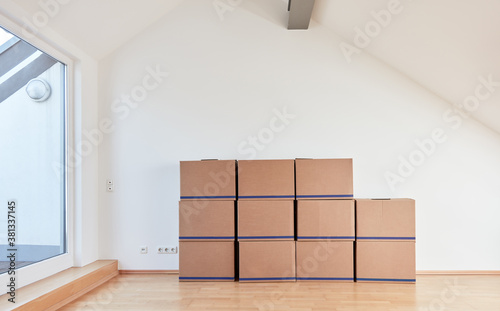 Fototapeta Moving boxes in the attic after moving to a new apartment obraz