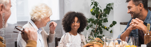Fototapeta selective focus of joyful african american girl celebrating thanksgiving day with family, horizontal image obraz