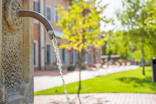 Drinking water fountain in the old town center. Canvas