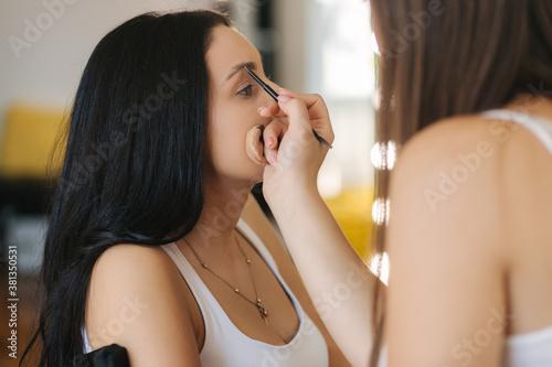 Fotografie, Obraz Makeup artist work with model in beauty studio
