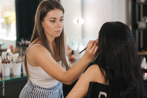 Obraz na plátně Makeup artist work in her beauty studio