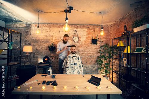 Fotografering Good looking man visiting barber shop