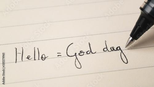 Fotomural Beginner Swedish or Norwegian language learner writing Hello formal word God dag