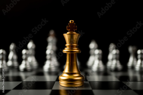 Fototapeta Golden King chess standing in front of other chess, Concept of a leader must have courage and challenge in the competition, leadership and business vision for a win in business games obraz