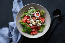 Greek Salad In Bowl On Black B...