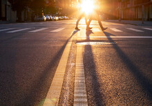 Man And Woman Walking Across T...