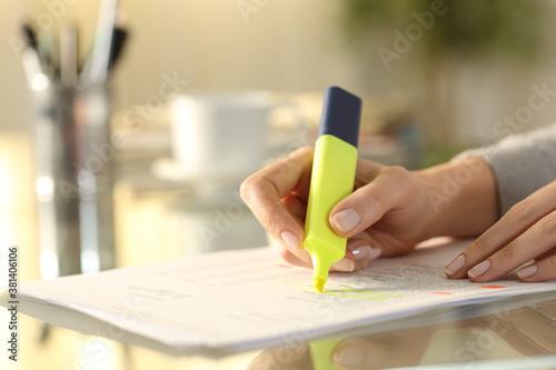 Fototapeta Woman hand underlining text on document with marker obraz