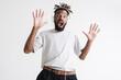 Photo of shocked african american guy in headphones expressing surprise