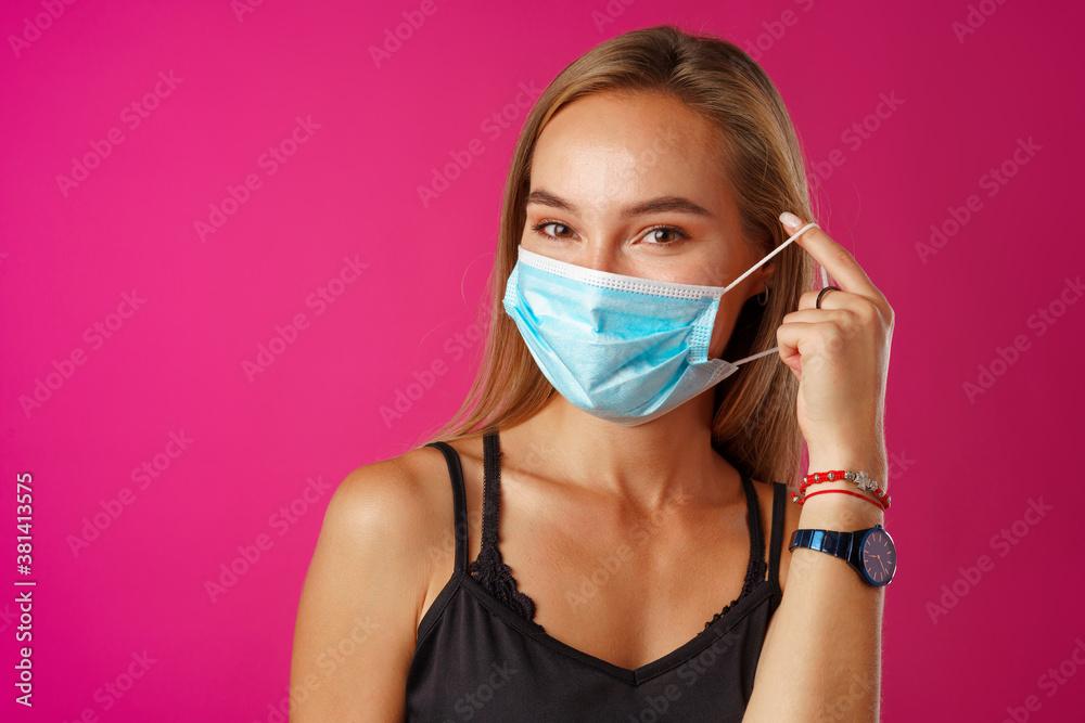 Fototapeta Young beautiful casual woman wearing protective medical mask
