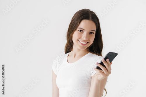Fototapeta Happy young woman wearing casual clothing obraz