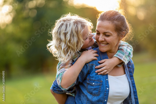 Fotografie, Obraz Mother and son having fun outdoors