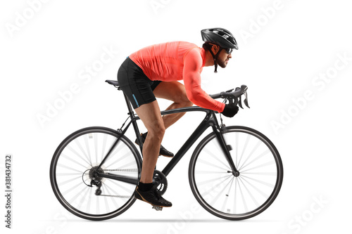 Profile shot of a male cyclist riding a road bicycle with spinning wheels Fotobehang