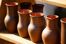 Brown Clay Pots Are In Rows. H...