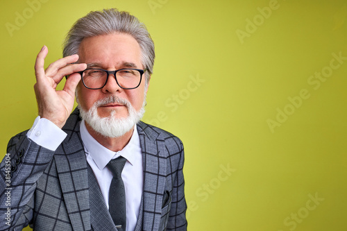mature male in suit peers through glasses, have bad eyesight Canvas Print