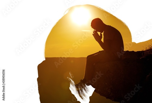 Young man pray outdoor on top of mountains in sunset Tapéta, Fotótapéta