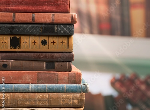 Photo Collection of old books stack on shelf background