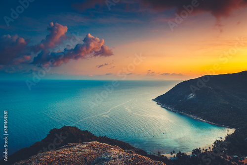 Fototapeta Silhouette Asia sunset aerial ocean bay at mountain forest, beach coast of Koh Tao Island, Thailand. Epic Thai landscape at warm sun set tones at cloud sky. Exotic isle in romantic cinematic view obraz
