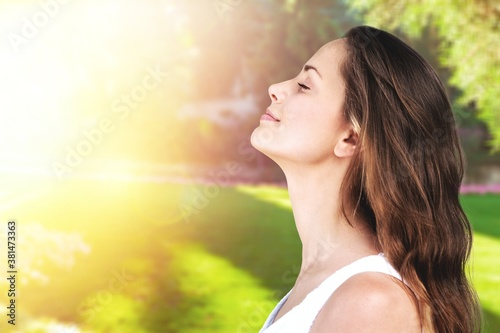 Young happy smile woman on a natural background Canvas Print