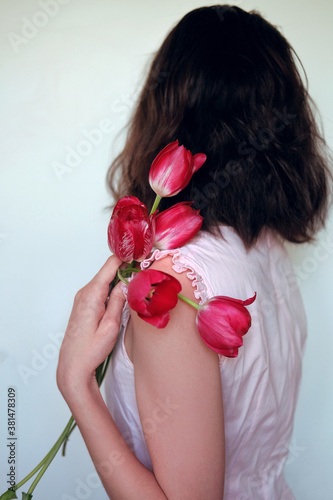 Valokuva Woman holding red tulips. Feminine tenderness concept