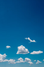 Bright Blue Sky With White Puffy Clouds