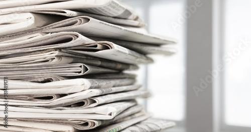 Pile of newspapers stacks on blur background Fotobehang