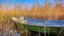 A Single Green-gray Boat Among...