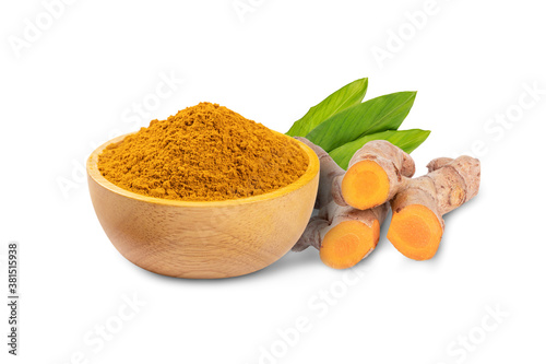 Fotografía Turmeric powder (curcuma longa linn)  in wooden bowl with root and leaves isolated on white background