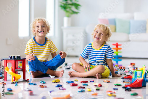Fototapeta Kids play with toy cars. Children playing car toys