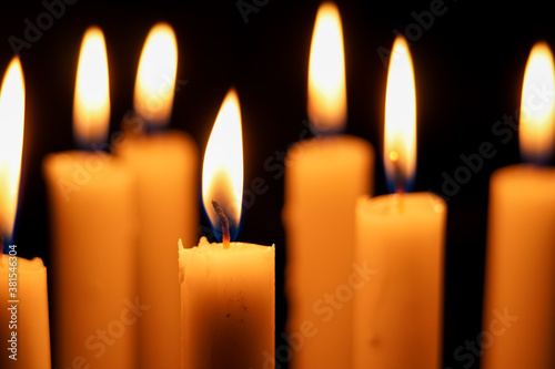 Close up photo of group candlelight in the dark, close up of burning candles in the dark Canvas Print