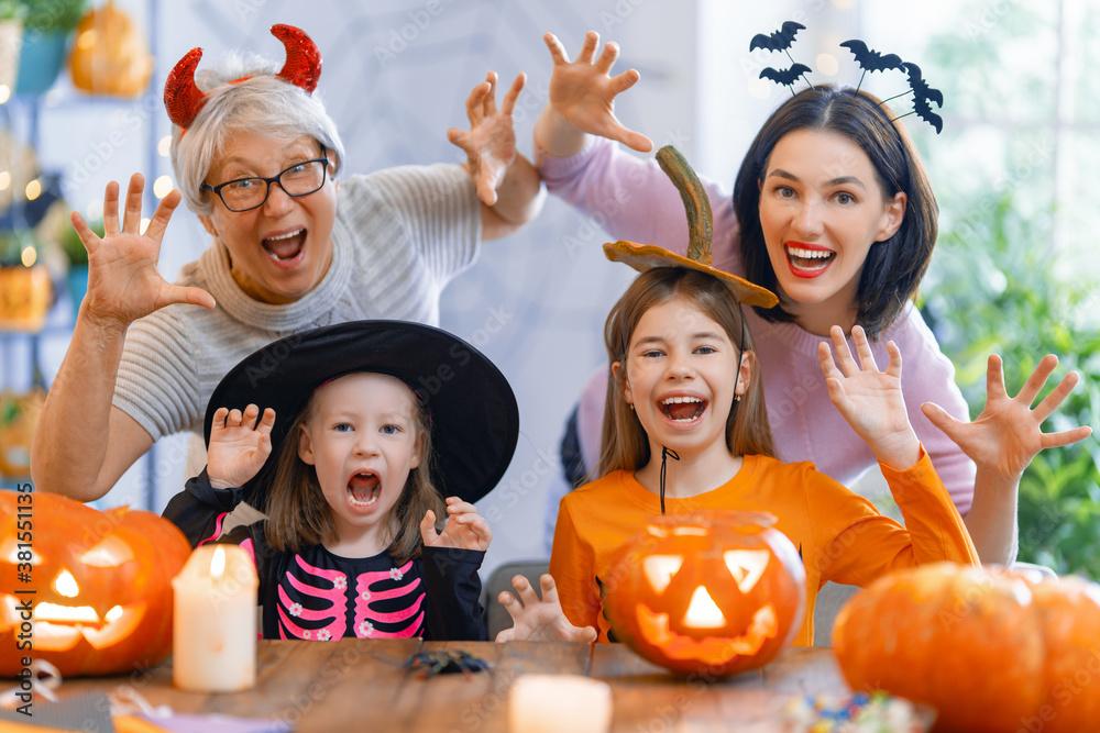 Fototapeta family celebrating Halloween