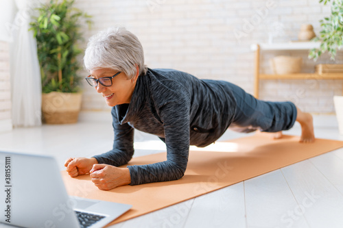 Senior woman exercising at home. Canvas